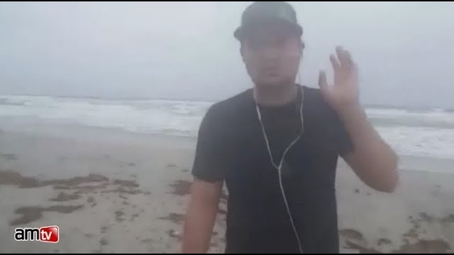 Man Refuses to Leave Beach as Hurrica...
