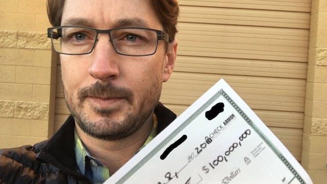 MAN CUTS CHECK FOR $100,000,000 BITCO...