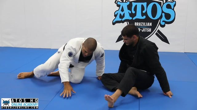 Leg Staple to Kimura Roll Attack From...