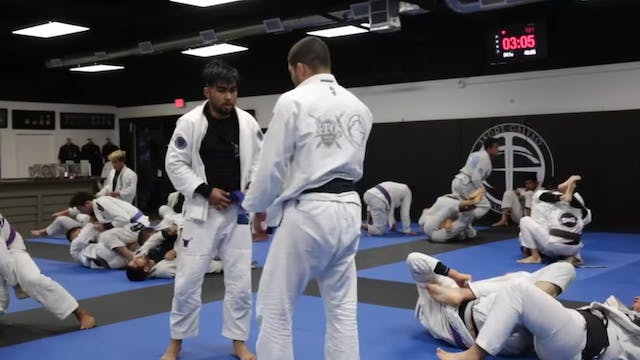 Andre Galvao Rolling Against a Blue Belt