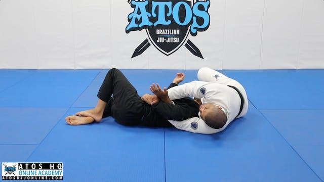 Leg Staple to Kimura Roll Attack