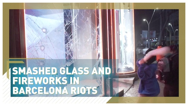 Smashed glass and fireworks in Barcelona riots