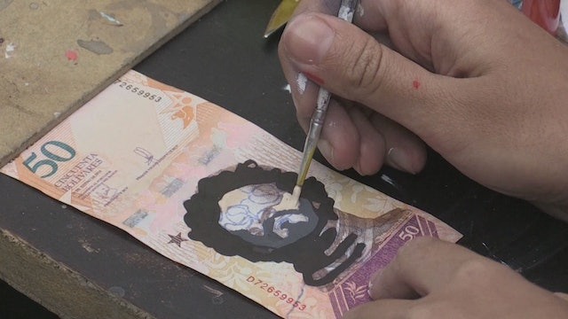 Venezuelans use currency to create art