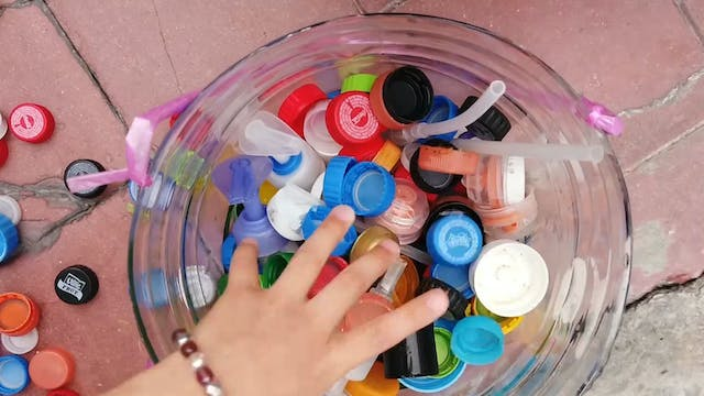 Recycling bottle caps to help kids