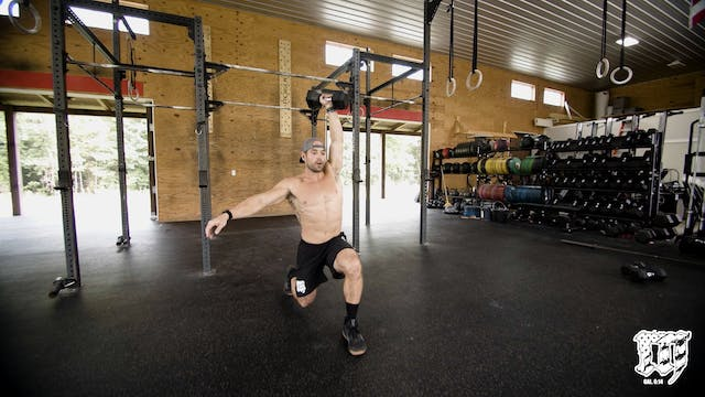 Single Arm DB Overhead Walking Lunge