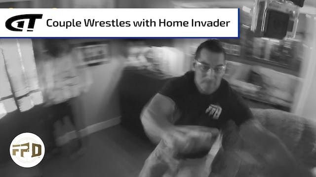 Couple Wrestles with Home Invader