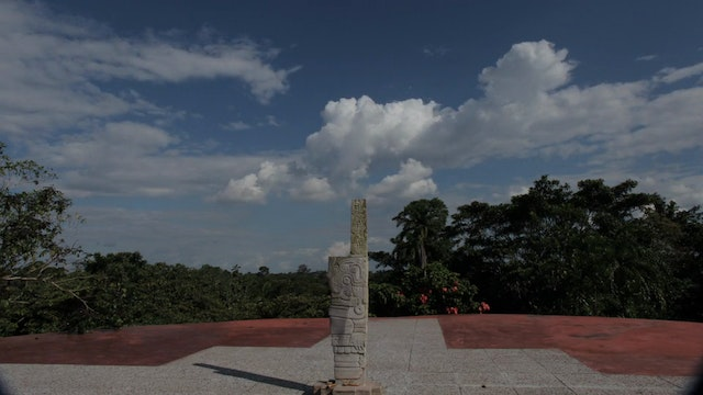 35. (TL) Sacred Site Statue in Center, Sky and Forest Day Time