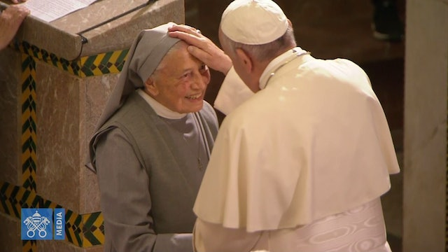 Pope warmly greets a nun and an elderly priest during a meeting in Morocco