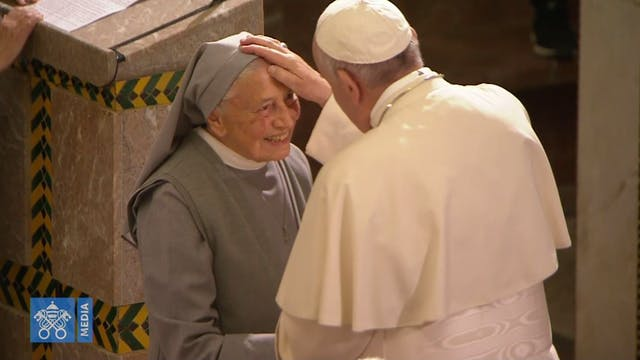 Pope warmly greets a nun and an elder...