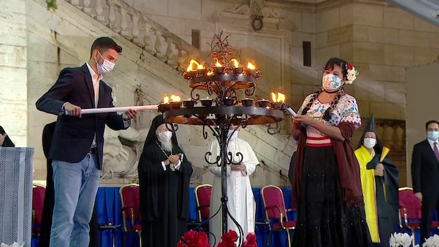 Latin American youth light candles for peace during interreligious meeting