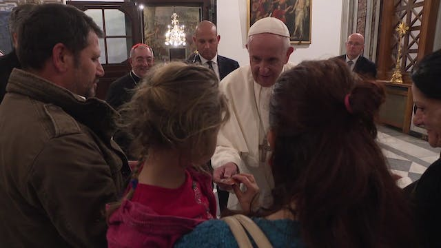 Pope meets gypsy family who have been...