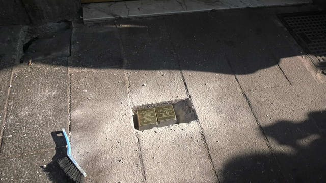 """Stumbling blocks"" dot Roman sidewalk..."