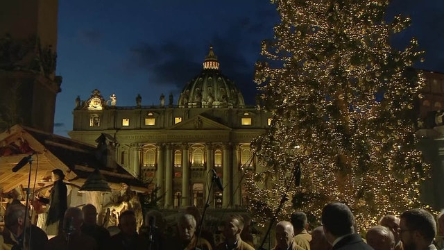 Nativity scene and Christmas tree light up St. Peter's Square