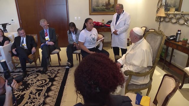 Pope Francis listens attentively to s...