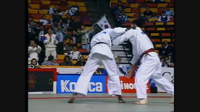 Kumi kata - Defending high right hand...