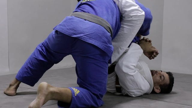Roger Gracie arm bar from climbing guard