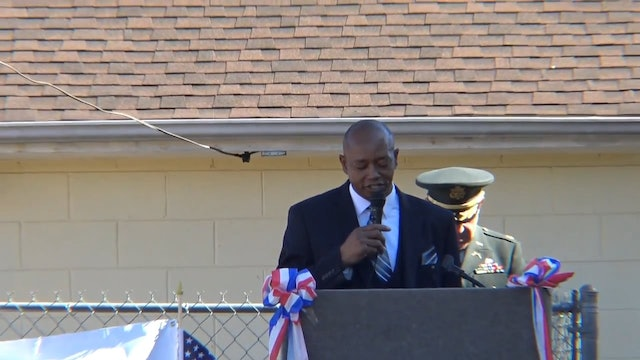 Pastor Hughes gives opening prayer at 1st Reinvest Veterans Day