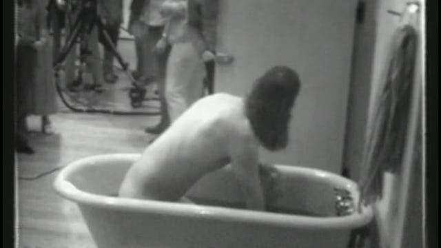 Naked artist performance at Yoko Ono's Everson Museum retrospective opening